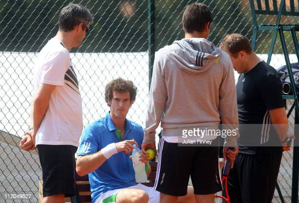 Andy Murray of Great Britain with Andy Ireland Daniel Vallverdu and Matt Little on a practice court during Day Three of the ATP Masters Series Tennis...