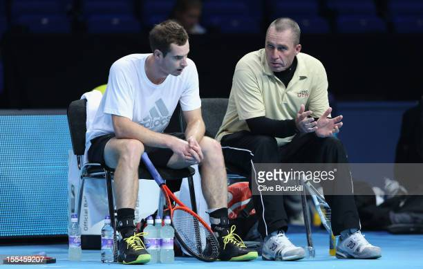 Andy Murray of Great Britain with his coach Ivan Lendl as they discuss tatics during a practice session prior to the start of ATP World Tour Finals...