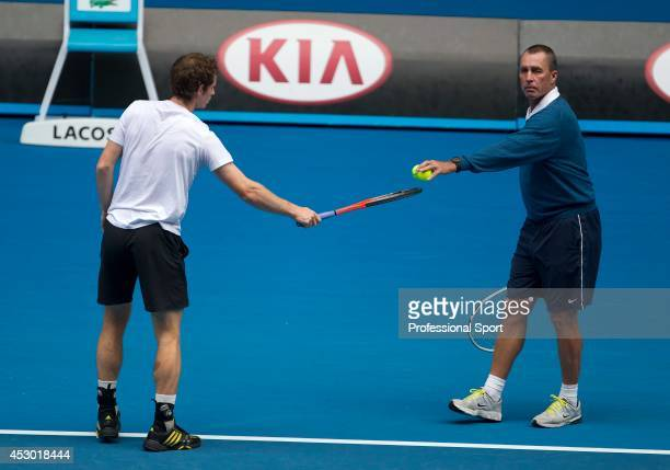 Andy Murray of Great Britain with his coach Ivan Lendl in a practice session during day thirteen of the 2013 Australian Open at Melbourne Park on...