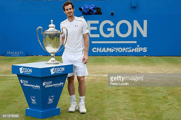 Andy Murray of Great Britain with the trophy after victory in the final against Milos Raonic of Canada on day 7 at Queens Club on June 19 2016 in...