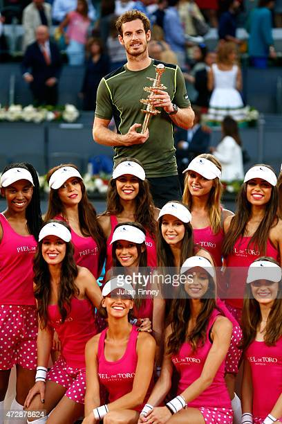 Andy Murray of Great Britain with the winners trophy along side the model ball girls after his win over Rafael Nadal of Spain in the final during day...
