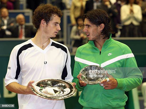Andy Murray of Great Britain with the winner's trophy with Rafael Nadal of Spain with the runners up's trophy after the singles final match during...