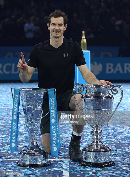 Andy Murray of Great Britainposes with the trophies following his victory during the Singles Final against Novak Djokovic of Serbia at the O2 Arena...