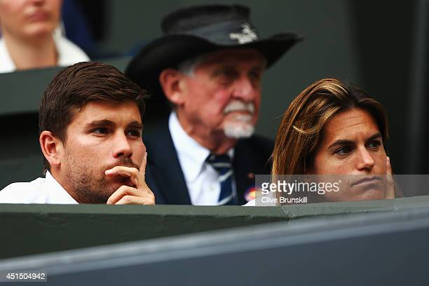 Andy Murray of Great Britain's coach Amelie Mauresmo looks on during his Gentlemen's Singles fourth round match against Kevin Anderson of South...