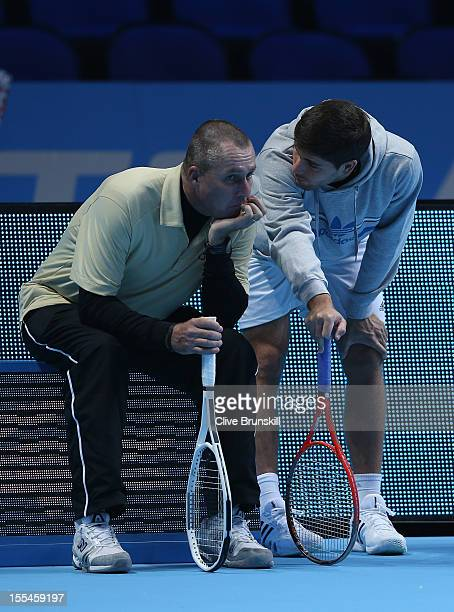 Andy Murray of Great Britain's coach Ivan Lendl and hitting partner Daniel Vallverdu discuss tatics during a practice session prior to the start of...