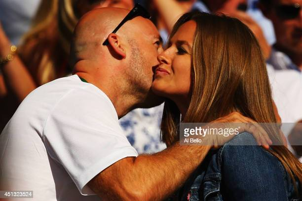 Andy Murray of Great Britain's girlfriend Kim Sears greets Murray's Fitness Coach Jez Green as they watch his Gentlemen's Singles third round match...