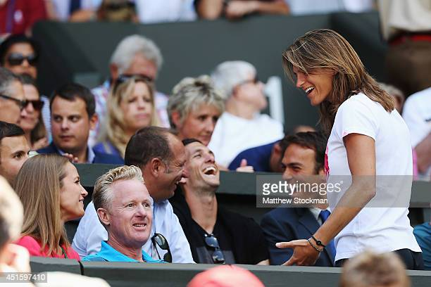 Andy Murray of Great Britain's girlfriend Kim Sears shakes a joke with his coach Amelie Mauresmo during his Gentlemen's Singles quarterfinal match...