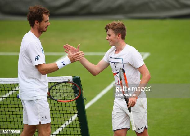 Andy Murray of Great Britains shakes hands with his hitting partner after his practice session ahead of the Wimbledon Lawn Tennis Championships at...