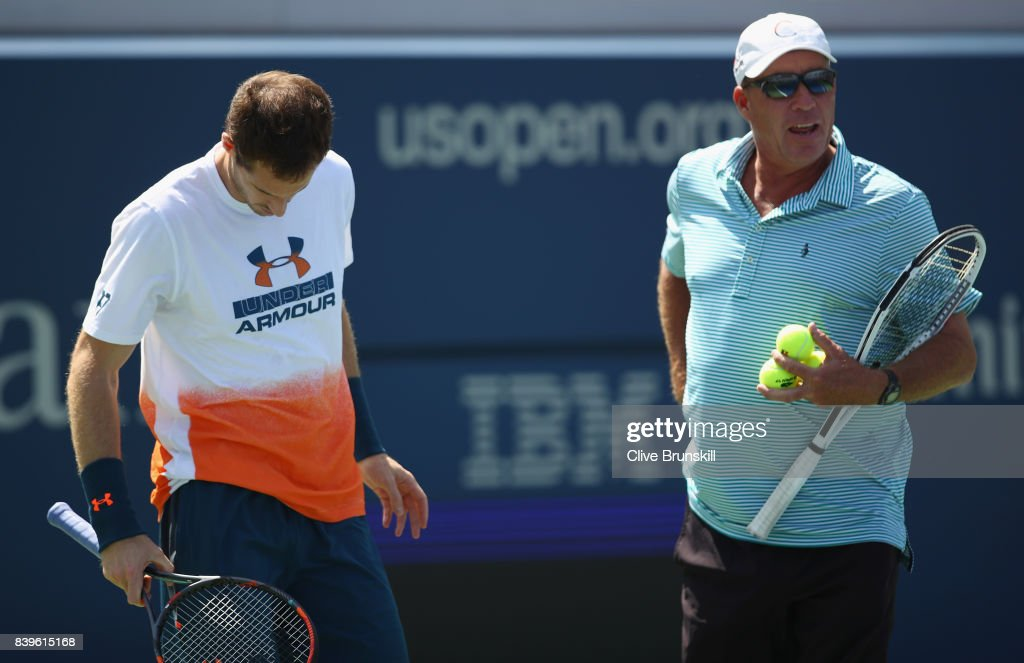 Andy Murray of Great Britian shows his frustrations as his coach Ivan Lendl looks on before withdrawing from the event during a practice session prior to the US Open Tennis Championships at USTA Billie Jean King National Tennis Center on August 26, 2017 in New York City.