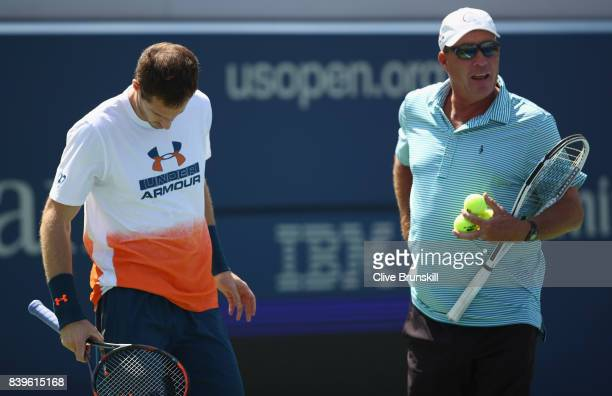 Andy Murray of Great Britian shows his frustrations as his coach Ivan Lendl looks on before withdrawing from the event during a practice session...