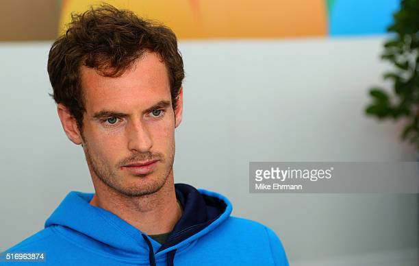 Andy Murray of Great Brittain talks to members of the media during Day 2 of the Miami Open presented by Itau at Crandon Park Tennis Center on March...