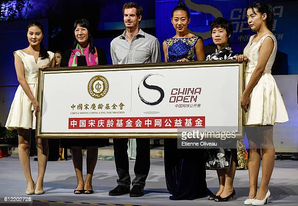Andy Murray of Scotland and Zhang Shuai of China pose for a picture with other players during the 2016 China Open Player Party at The Birds Nest on...