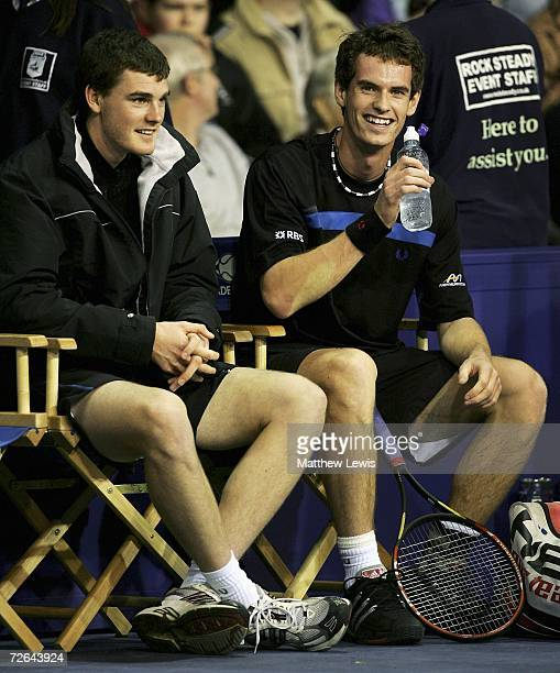 Andy Murray of Scotland laughs with brother Jamie Murray during the game against Greg Rusedski of England during the Aberdeen Tennis Cup at The...