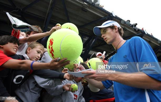 Andy Murray of Scotland signs autographs after beating Alessio Di Mauro of Italy during the US Open at the USTA Billie Jean King National Tennis...