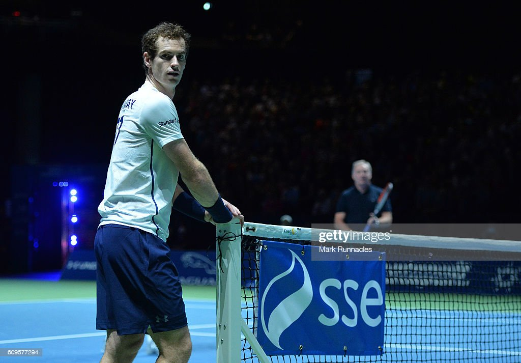 Andy Murray of Scotland takes a breather during the doubles match between Andy Murray and Jamie Murray of Scotland and Tim Henman of England and Grigor Dimitrov of Bulgaria at Andy Murray Live presented by SSE at the SSE Hydro on September 21, 2016 in Glasgow, Scotland.