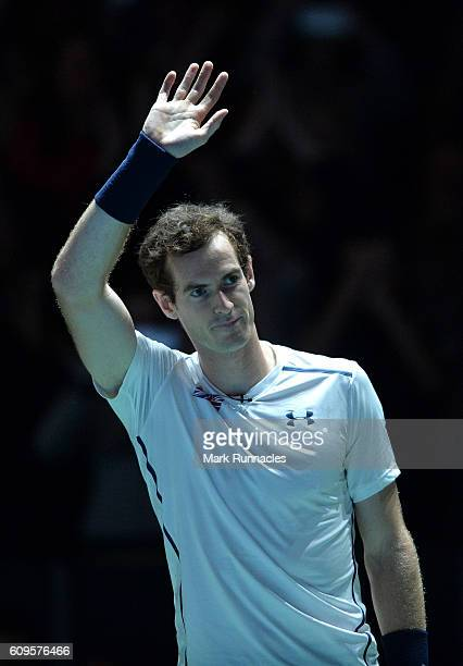 Andy Murray of Scotland waves to the crowd during the doubles match between Andy Murray and Jamie Murray of Scotland and Tim Henman of England and...