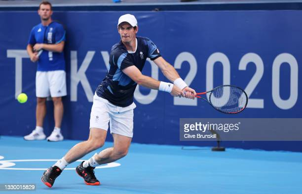 Andy Murray of Team Great Britain plays a backhand as Davis Cup Captain Leon Smith watches during the practice session ahead of the Tokyo 2020...