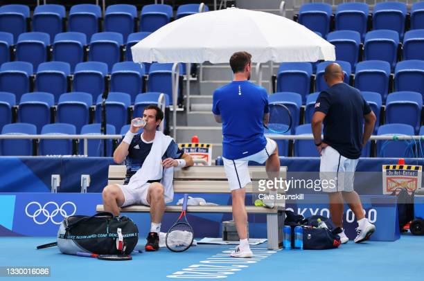 Andy Murray of Team Great Britain takes a break alongside Davis Cup Captain Leon Smith and physio Shane Annun looks on during the practice session...