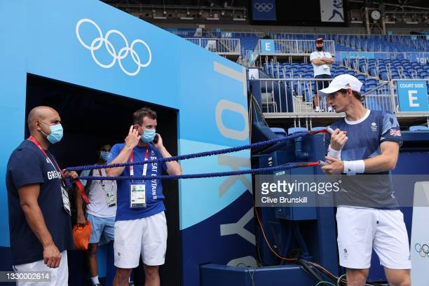 Andy Murray of Team Great Britain warms up with physio Shane Annun as he talks to Davis Cup Captain Leon Smith during the practice session ahead of...