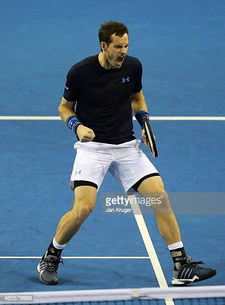 Andy Murray of The Aegon GB Davis Cup Team celebrates a point in his singles match against John Isner of the United States during day 3 of the Davis...