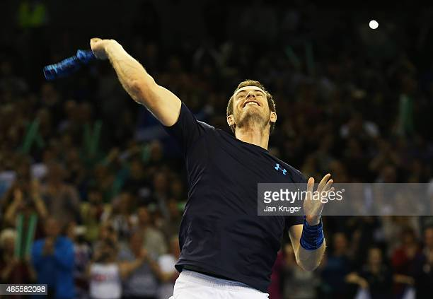 Andy Murray of The Aegon GB Davis Cup Team celebrates victory in his singles match against John Isner of the United States during day 3 of the Davis...