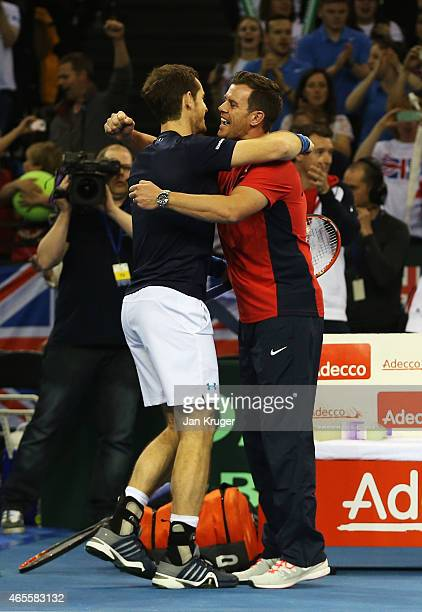Andy Murray of The Aegon GB Davis Cup Team celebrates victory with Leon Smith Captain of The Aegon GB Davis Cup Team after his singles match against...