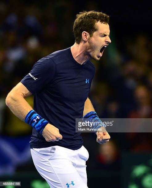 Andy Murray of the Aegon GB Davis Cup Team reacts after beating John Isner of the United States and completing the Aegon GB Davis Cup Teams victory...