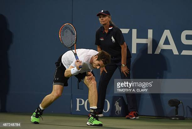 Andy Murray of the UK breaks his racket against Kevin Anderson of South Africa during their 2015 US Open men's singles round four match at the USTA...