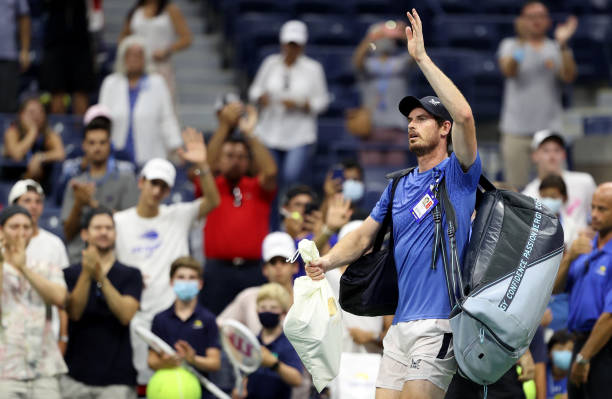 Andy Murray of United Kingdom waves to the crowd after losing to Stefanos Tsitsipas of Greece during their men's singles first round match on Day One...