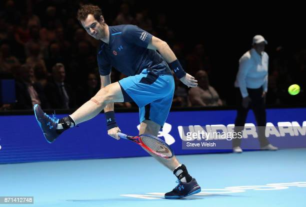 Andy Murray partner of Jamie Murray returns the ball during their doubles match against Mansour Bahrami and Tim Henman during Andy Murray Live at The...