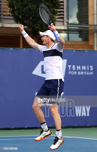 Andy Murray partner of Naomi Broady of Union Jacks celebrate in their mixed doubles match against Emma Raducanu and Kyle Edmund of British Bulldogs...