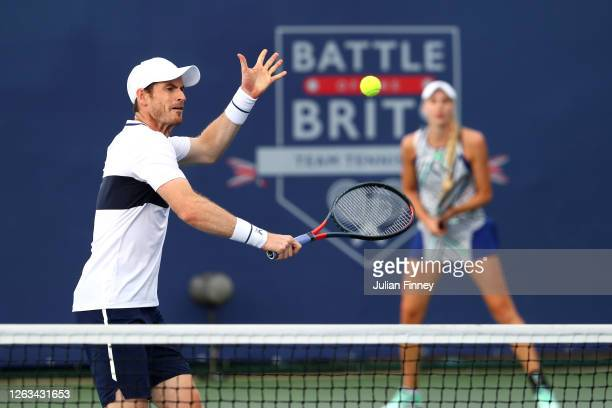 Andy Murray partner of Naomi Broady of Union Jacks plays a backhand in their mixed doubles match against Emma Raducanu and Kyle Edmund of British...