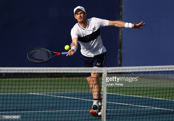 Andy Murray partner of Naomi Broady of Union Jacks plays a forehand in their mixed doubles match against Emma Raducanu and Kyle Edmund of British...
