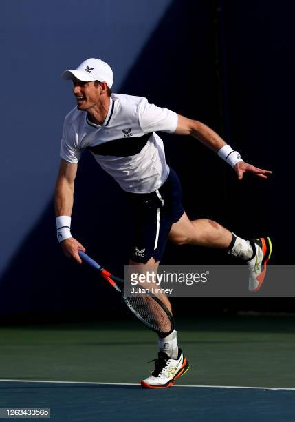 Andy Murray partner of Naomi Broady of Union Jacks serves in their mixed doubles match against Emma Raducanu and Kyle Edmund of British Bulldogs...