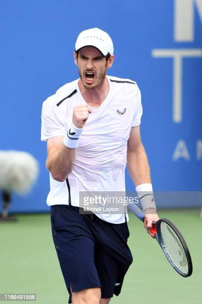 Andy Murray playing with his brother Jamie Murray of Great Britain celebrates a shot during their doubles match against Nicolas Mahut and Edouard...