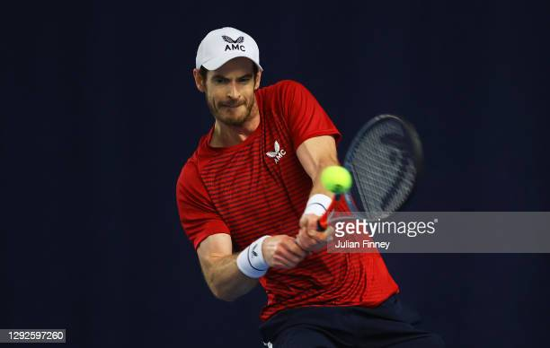 Andy Murray plays a backhand shot during their round robin match against Cameron Norrie during Day Three of the Battle of the Brits Premier League of...