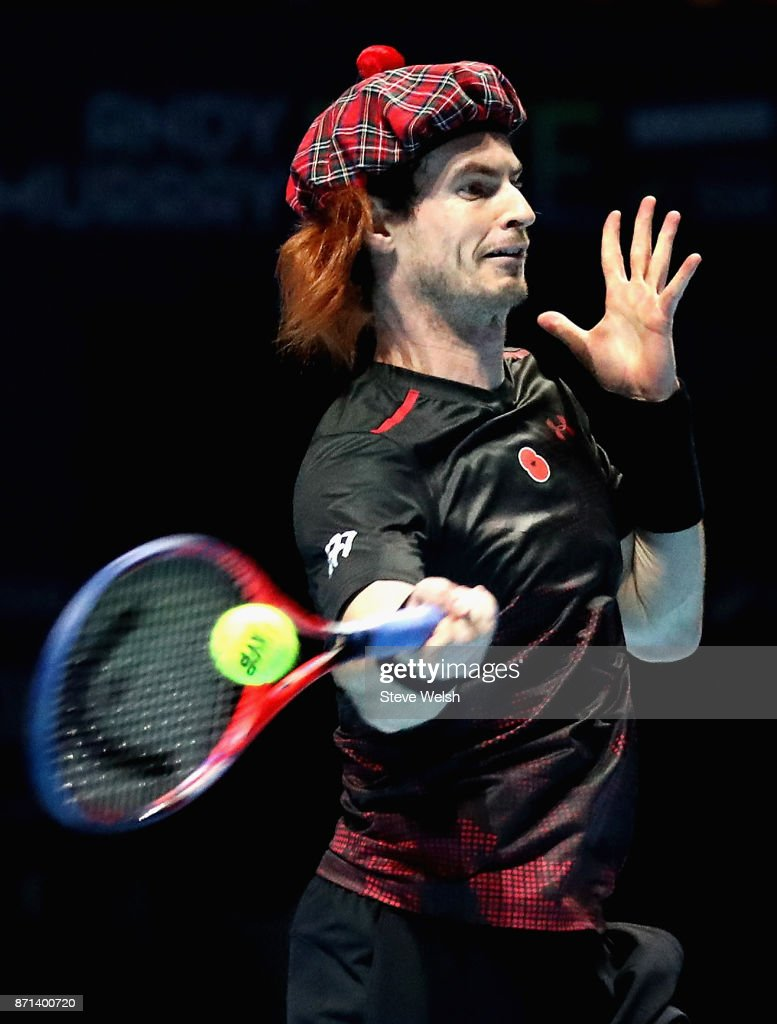 Andy Murray made his court comeback with an exhibition game against Roger Federer in Glasgow. He took off the accessories for the actual match.