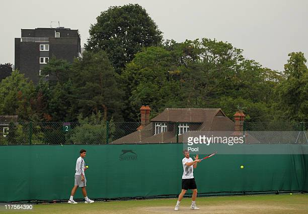 Andy Murray practices with hitting partner Daniel Vallverdu on Day Eight of the Wimbledon Lawn Tennis Championships at the All England Lawn Tennis...