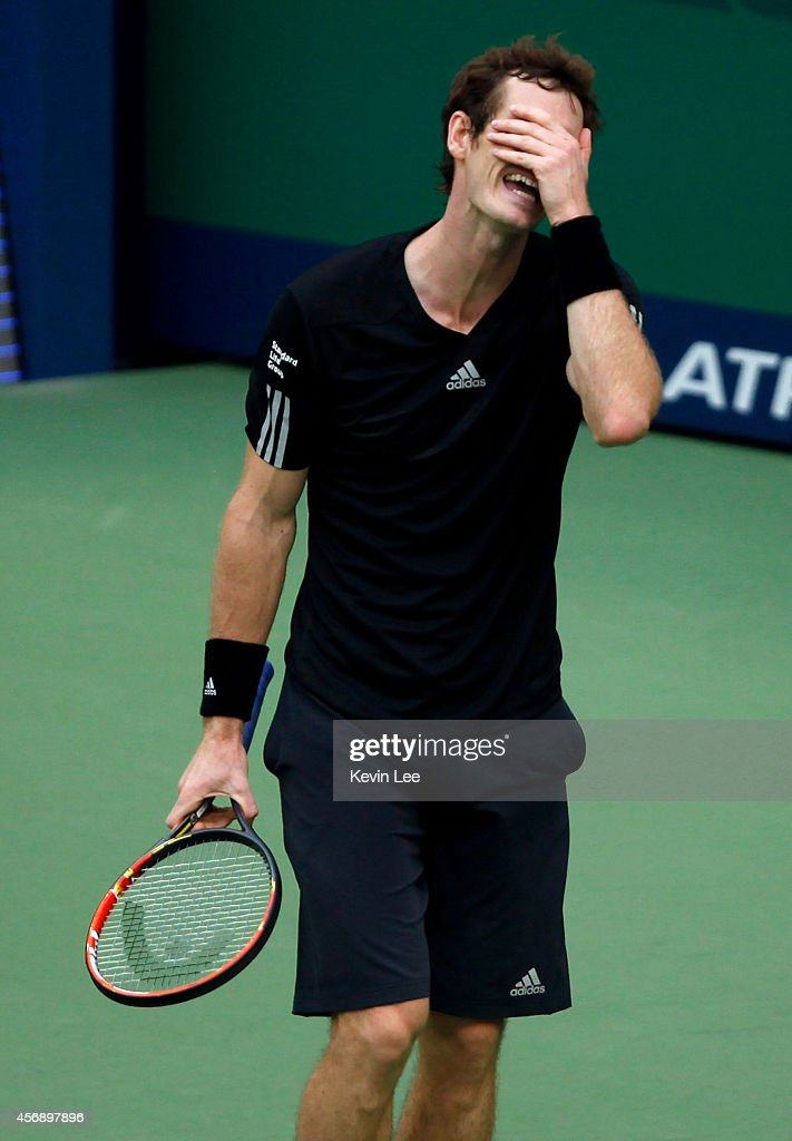 Andy Murray reacts after a game during his match against David Ferrer of Spain during day 5 of the Shanghai Rolex Masters at Zi Zhong stadium on October 9, 2014 in Shanghai, China. David Ferrer defeats Andy Murray by 2-6, 6-1, 6-2.