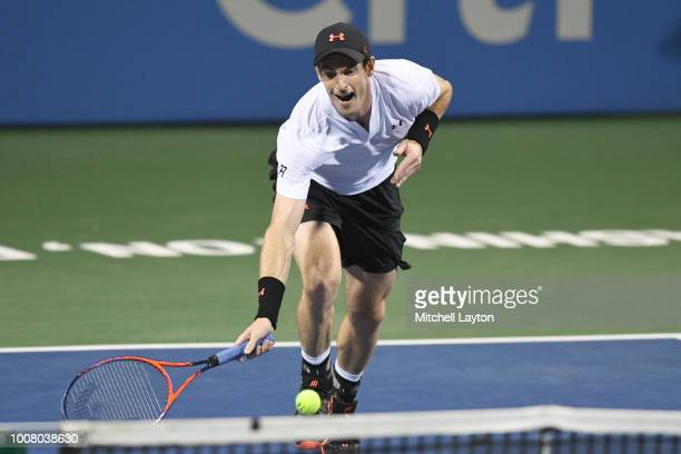 Andy Murray returns a dives for a shot from Mackenzie McDonald during the Citi Open at the Rock Creek Tennis Center on July 30 2018 in Washington DC