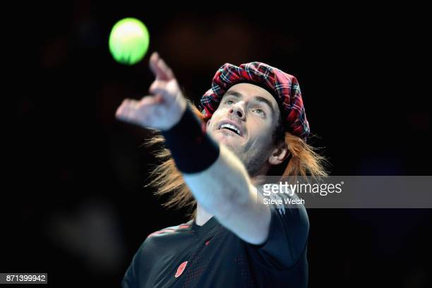 Andy Murray serves during his match against Roger Federer during Andy Murray Live at The Hydro on November 7 2017 in Glasgow Scotland