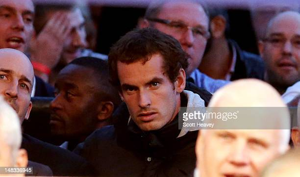 Andy Murray sits in the crowd before the vacant WBO and WBA International Heavyweight Championship bout between David Haye and Dereck Chisora on July...