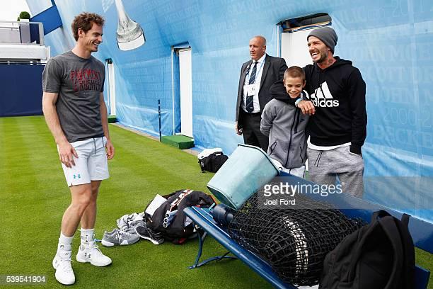 Andy Murray speaks with David Beckham and his son Romeo after the boy hit a few balls with Murray prior to a practice session at the Aegon...