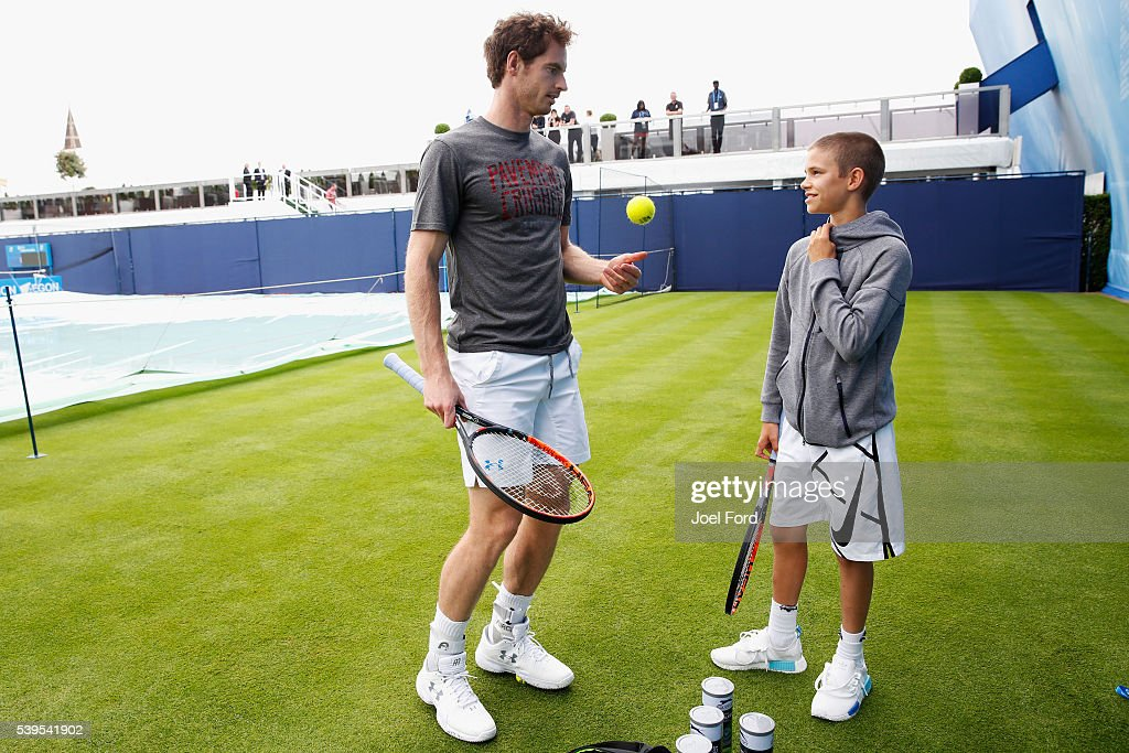Andy Murray (L) speaks with Romeo Beckham, the son of formr footballer David Beckham after the pair hit a few balls prior to Murray's practice session at the Aegon Championships at Queens Club on June 12, 2016 in London, England.