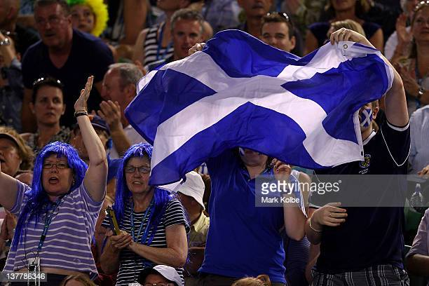Andy Murray supporters wave the flag of Scotland during the semifinal match between Andy Murray of Great Britain and Novak Djokovic of Serbia during...