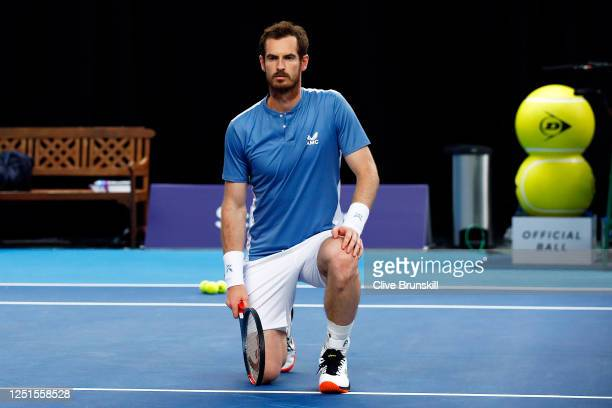 Andy Murray takes a knee in solidarity with the BLM movement ahead of his match against Liam Broady on day 1 of Schroders Battle of the Brits at the...