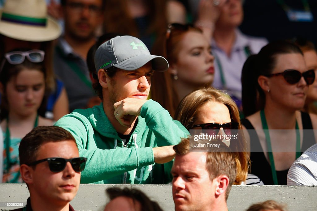 Andy Murray watches John Peers of Australia and Jamie Murray of Great Britain in action in the Final Of The Gentlemen's Doubles against Horia Tecau of Romania and Jean-Julien Rojer of Netherland during day twelve of the Wimbledon Lawn Tennis Championships at the All England Lawn Tennis and Croquet Club on July 11, 2015 in London, England.