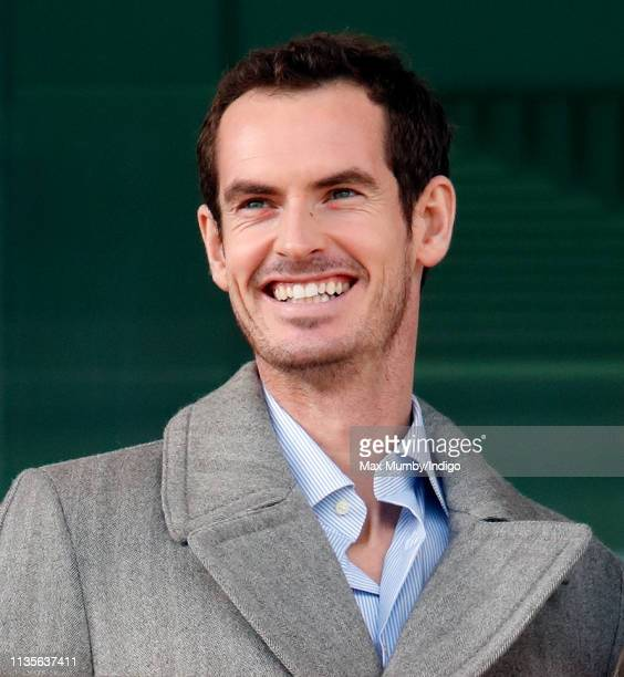 Andy Murray watches the racing as he attends day 2 'Ladies Day' of the Cheltenham Festival at Cheltenham Racecourse on March 13 2019 in Cheltenham...