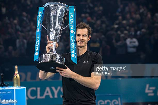 Andy Murray wins the Championships against Novak Djokovic and celebrates with the awards