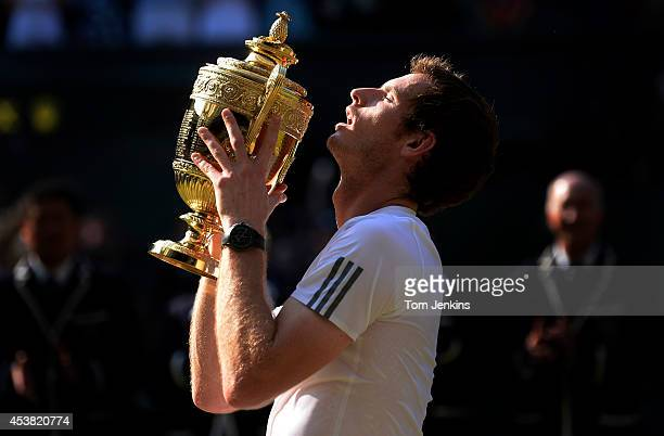 Andy Murray with the trophy at the presentation after the mens singles final on Centre Court during Wimbledon 2013 day thirteen at the All England...